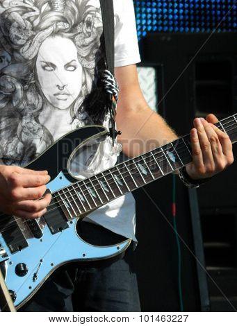 Rock musician playing electric guitar