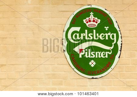 Old advertising of Carlsberg on a wall