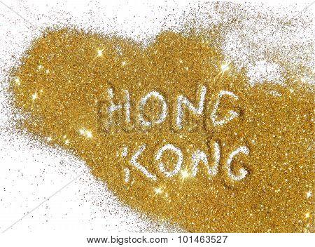 Inscription Hong Kong on golden glitter sparkles on white background