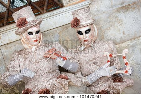 VENICE, ITALY - FEBRUARY 27, 2014: Unidentified person with Venetian Carnival mask in Venice, Italy on February 2014. 