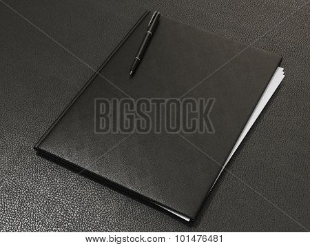 Folder And Office Supplies On Brown Leather