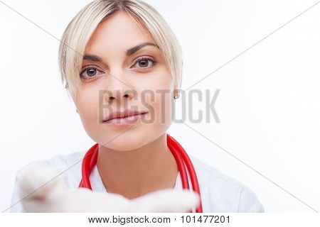 Attractive young female physician is working in her office