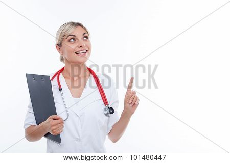 Attractive young female doctor is working with interest