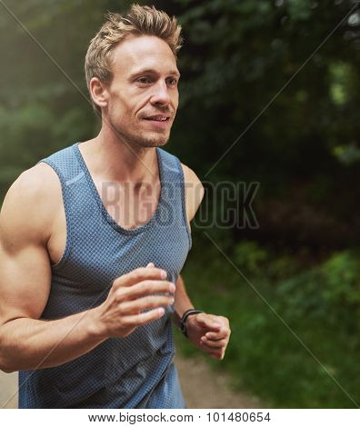 Handsome Muscular Man Jogging At The Park