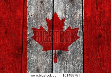 Canada Flag On Heavily Textured Woodgrain