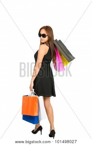 Asian Shopper Walking Away Looking Over Shoulder