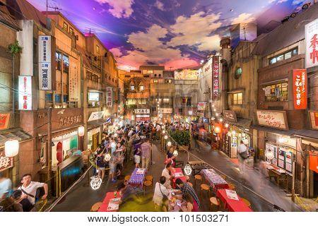 YOKOHAMA, JAPAN - AUGUST 11, 2015: Crowds in the Shinyokohama Raumen Museum. The exhibit is a 1:1 replica of the historic Shitamachi district of Tokyo and offers regional Ramen restaurants.
