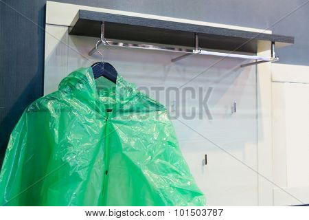 Green raincoat