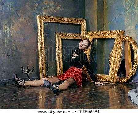beauty rich brunette woman in luxury interior near empty frames, vintage elegance close up