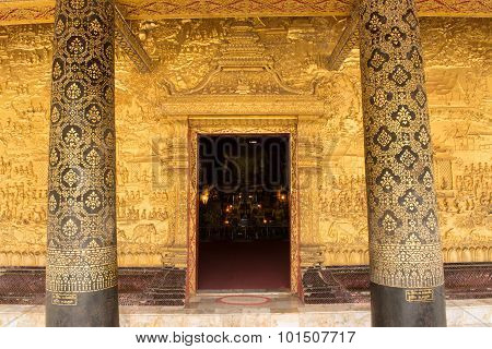 .this Image Shows A Wat Detail, Door, Wall, Pole,  In  Wat Mai  (luang Prabang, Laos)