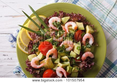 Salad With Avocado, Shrimp And Vegetables Closeup. Horizontal Top View