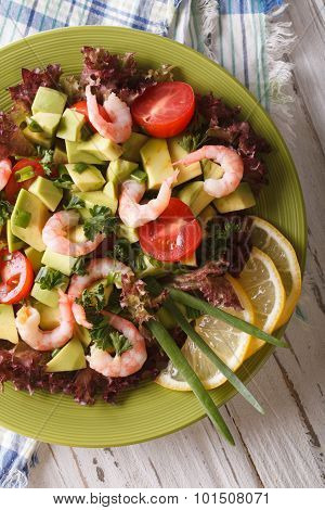 Fresh Avocado Salad With Shrimp And Vegetables Closeup. Vertical Top View
