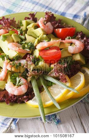 Avocado Salad With Shrimp Close-up On A Plate. Vertical