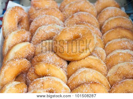 Cooking, Asian Kitchen, Sale And Food Concept - Sugared Donuts Texture. Selective Focus