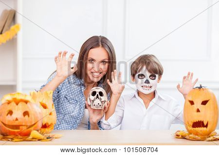 Pretty mother and son are having fun on Halloween