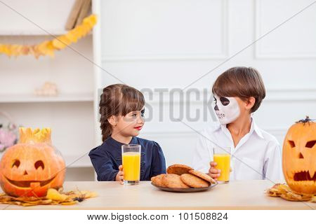 Cute children are enjoying sweet food on Nut-Crack Night