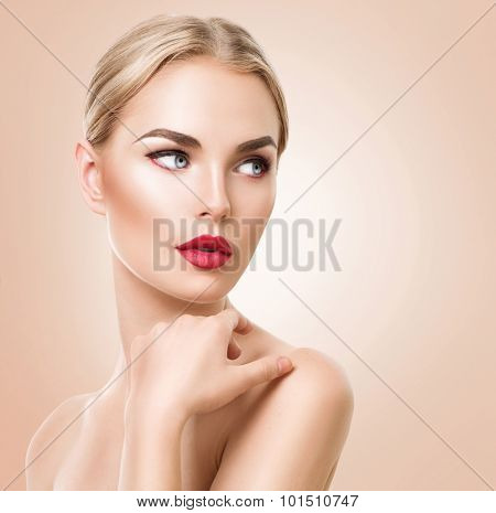 Beautiful woman portrait. Beauty Spa woman  with perfect fresh skin and perfect makeup. Pure Beauty blonde model girl over beige background. Youth and Skin Care Concept