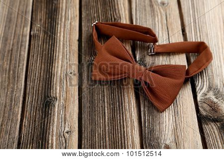 Brown Bow Tie On A Brown Wooden Table