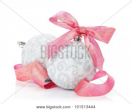 Christmas baubles and red ribbon. Isolated on white background