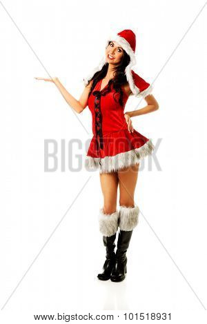Santa woman holding something invisible in right hand.