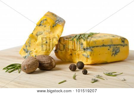 The Nutmeg With Two Pieces Of Cheese On Wooden Table
