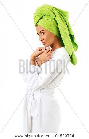 Spa woman in bathrobe and towel on head.