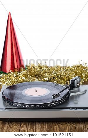 Shiny party hat with record player