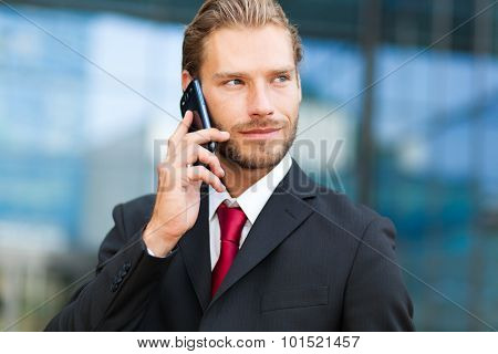 Handsome man talking at the phone outdoor