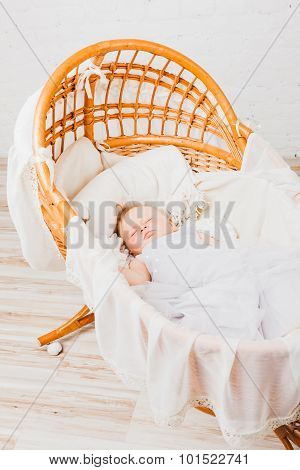 Baby girl sleeping in cradle