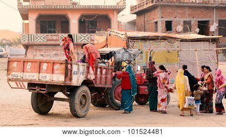 Women ready to travel on tractor.