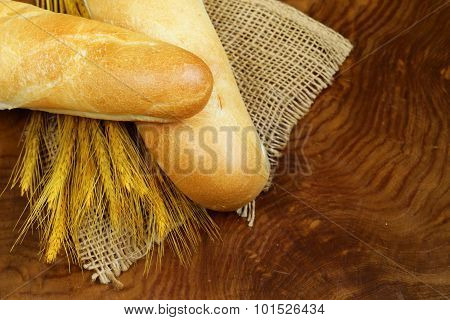 fresh French baguette (bread) on wooden background