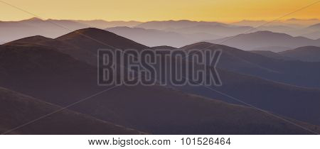 Mountain Peaks At Sunset Haze