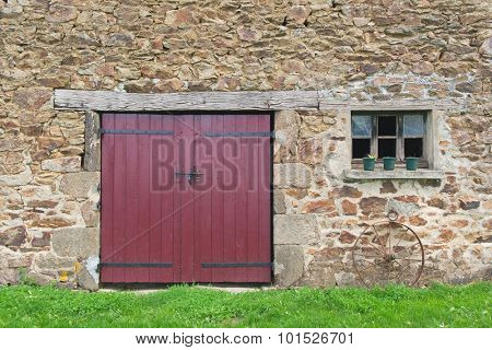 Old French barn with doors and window