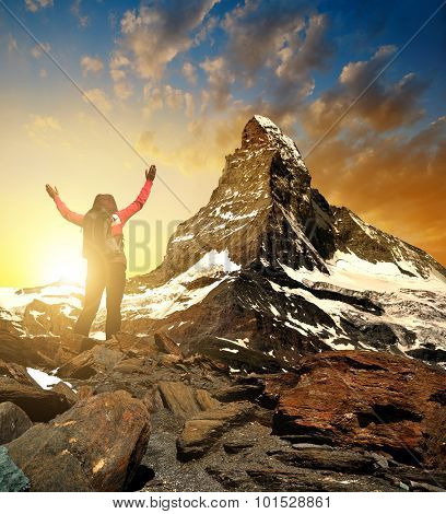 Girl in the mountains, in the background mount Matterhorn - Pennine Alps, Switzerland