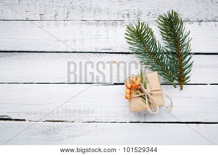 Small package and firtree conifer over wooden background