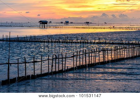 Silhouette Of Bamboo Cottage With Morning Sunshine In Gulf Of Thailand At Bang Tabun, Phetchaburi, T