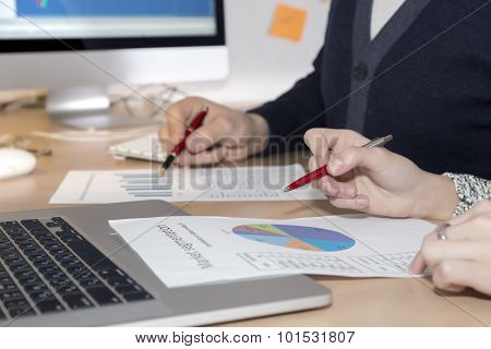 Hands of people working on presentation