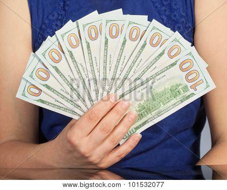 Woman Holding New 100 Us Dollar Bills