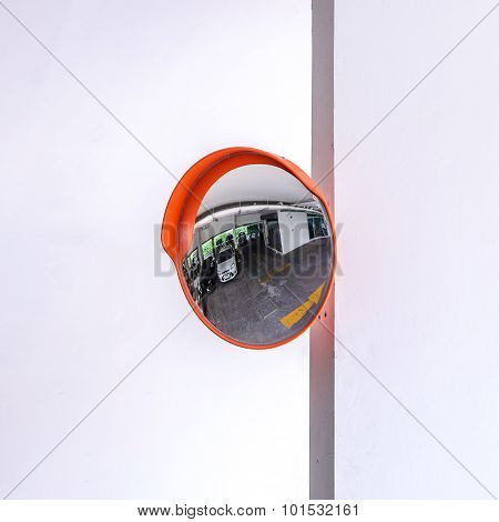 Traffic convex mirror at car park for safety.