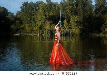 Girl Stands Near A Pole Dance.