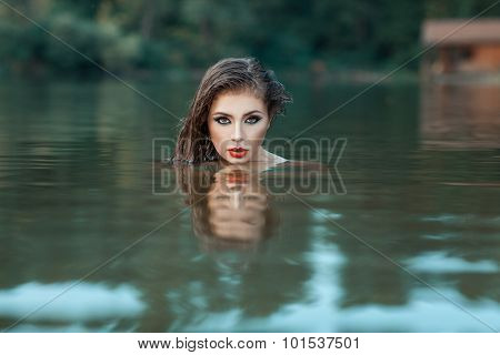 Girl's face peeking out of the water.