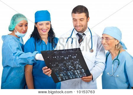 Group Of Doctors Discussion About Mri