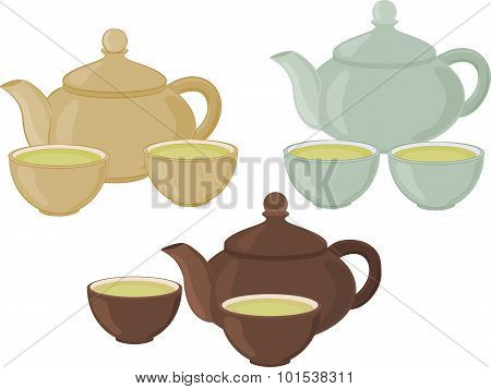Set of cups of tea and teapot on a white background.