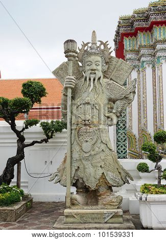 Chinese Guardian Figure At A Gate