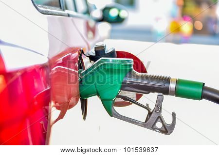 Refueling A Red Car At The Gas Station.