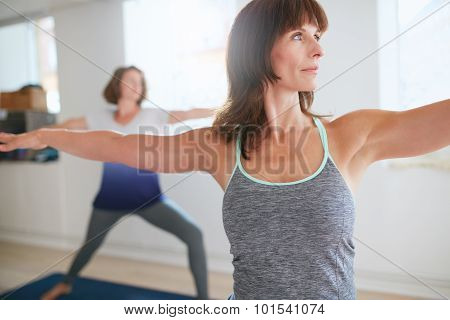 Fitness Trainer Doing The Warrior Pose At Yoga Class