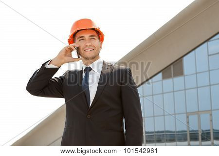 Young engineer talking on the phone