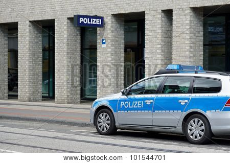 german police car and station