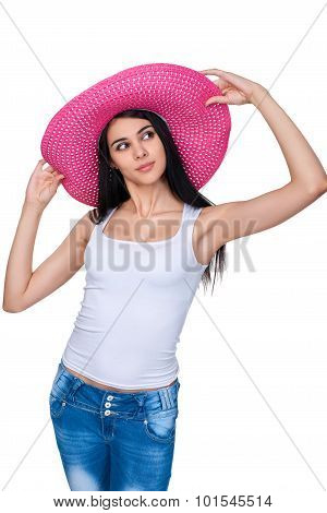 Casual woman in pink straw hat