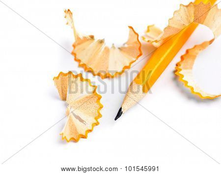Sharpened pencil and wood shavings isolated